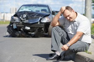 22086496-Adult-upset-driver-man-in-front-of-automobile-crash-car-collision--Stock-Photo