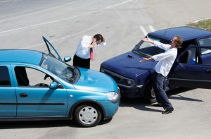 Traffic accident and two drivers fighting