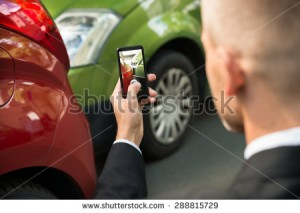 stock-photo-male-driver-photographing-with-his-cellphone-after-traffic-collision-288815729